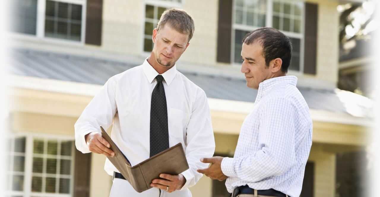 Men-Discussing-Property-Mangement-with-owner